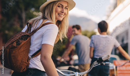 Woman with friends on city tour with bike - 204295633