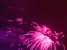 Dramatic Pink Fireworks At Night Sky Background