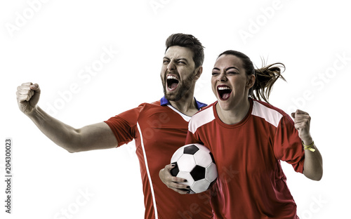 Young couple fan in red uniform celebrating