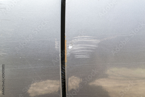 Fotografie, Obraz  Scratches on the car body