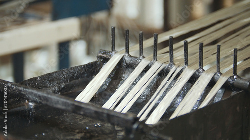 Producing fiberglass rods - manufacture of composite reinforcement, industry for Canvas Print