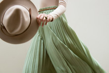 Hat, Beige Blouse And Turqoise...