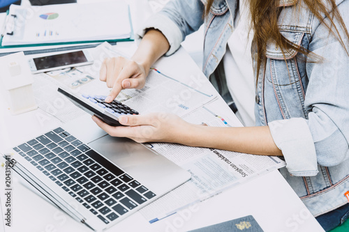 Fototapeta Accounting Financial Concept: Business people or accountant using calculator in office to calculate company expense obraz