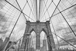 Black and white picture of the Brooklyn Bridge, New York City, USA.
