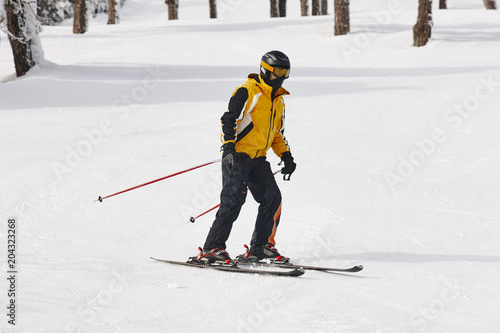 Poster Wintersporten Man starting to learn how to ski. Winter sport.
