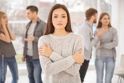 Canvas Print Sad woman during group therapy, indoors