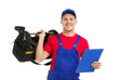 Young plumber with tool bag and clipboard on white background