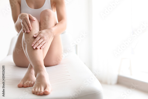 Fotobehang Spa Young woman showing smooth silky skin after epilation at home