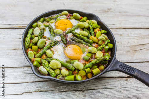 Fried shakshouka with seasonal vegetables asparagus and broad bean.