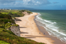 Panoramic View Of People Walking On Whiterocks Beach Portrush, Northern Ireland