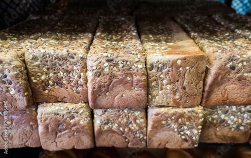 Foto op Plexiglas Brood Fresh sesame, oatmeal and sunflower seeds dark bread for sale at farmers market