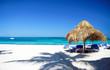 Beach chairs and sun umbrella on tourist resort beach