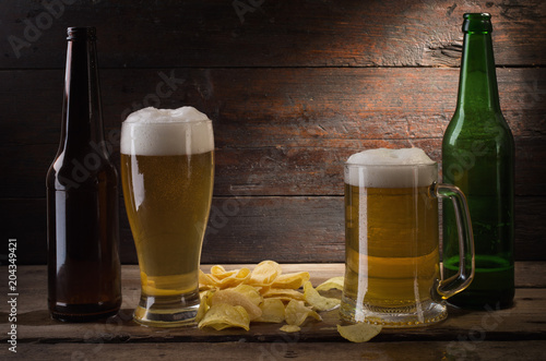 Foto op Canvas Bier / Cider bottle and glass with beer on wood table