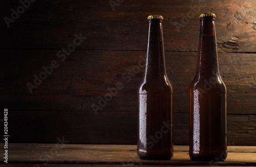 Fotobehang Bier / Cider bottle of beer on a wooden background
