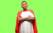 canvas print picture - African black super hero man with crossed arms confident and happy with a big natural smile laughing
