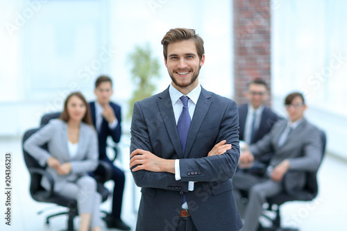 Successful businessman at the office leading a group Fototapet