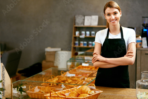 Fotografie, Obraz  Pastry Shop. Portrait Of Young Woman Working In Bakery
