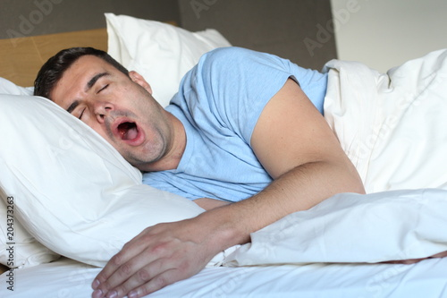 Photo  Funny man snoring in bed