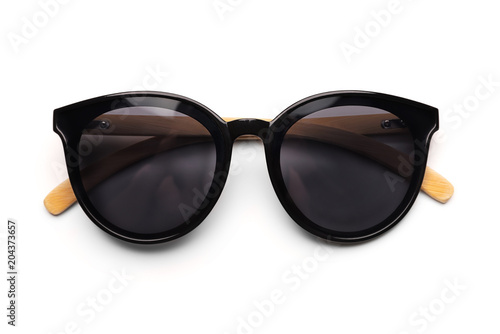 Black sunglasses with bamboo frames isolated on a white background