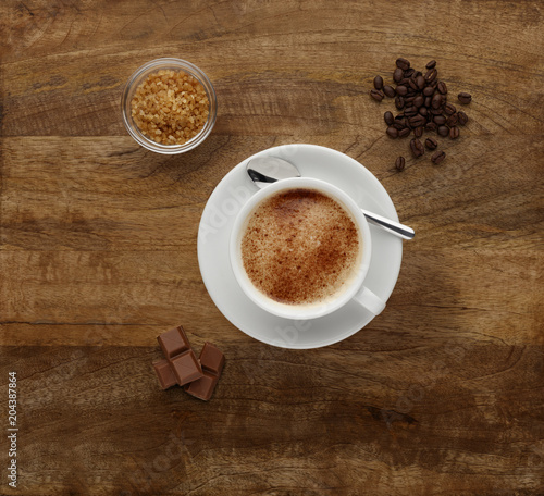Fotografie, Obraz  A Mocha coffee, shot on a wooden worktop, with coffee beans and chocolate