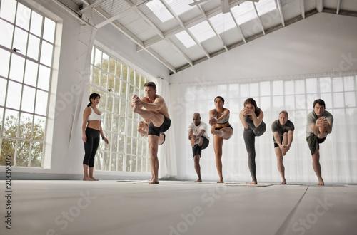 People practicing yoga in yoga class