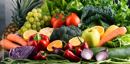 Composition with variety of raw organic vegetables and fruits © monticellllo