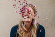Blonde tossing confetti in celebration