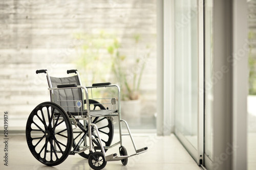 Empty wheelchair in a home interior.