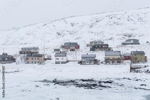 Papiers peints Arctique Houses in frozen landscape in winter, Nordkapp, Norway