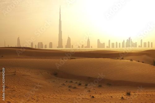Fotobehang Dubai Skyline of Dubai at sunset or dusk, view from Arabian Desert