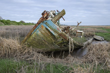 An Abandoned Boat Decaying On ...