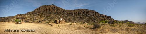 Old abandoned ruins in a desert landscape.