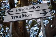 Innovation Or Tradition: Marketing Decision Road Sign With Opposite Direction Arrows. Business And Life Choice Concept.