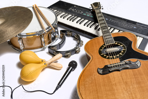 Obraz na plátně a group of musical instruments including a guitar, drum, keyboard, tambourine