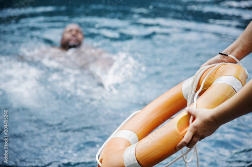 Man being rescued from the water Fototapeta