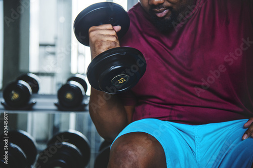 Fotografie, Obraz  Man lifting weights at the gym