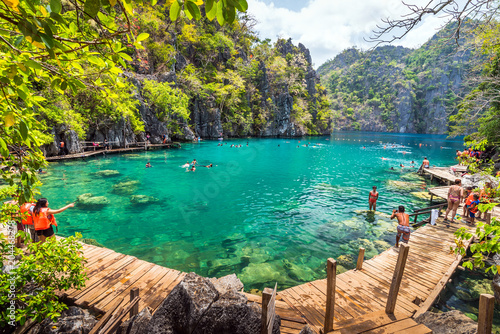 Wall Murals Bali Palawan, Philippines - March 29, 2018. People tourists swimming at Kayangan Lake in Coron Island, Palawan, The Philippines.