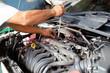 Close up shot, Car mechanic replacing spark plug into engine at maintenance repair service station