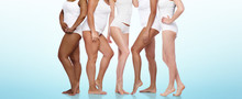Beauty, Body Positive And People Concept - Group Of Diverse Women In White Underwear Over Blue Background