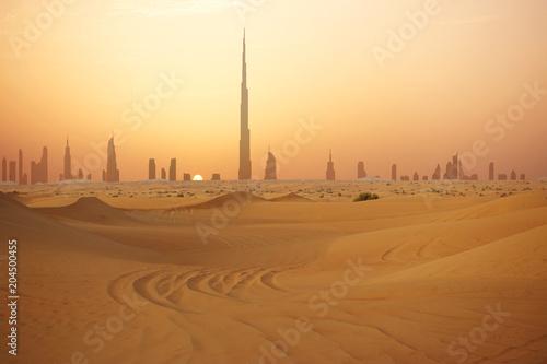 Fotobehang Dubai Dubai city skyline at sunset seen from the desert