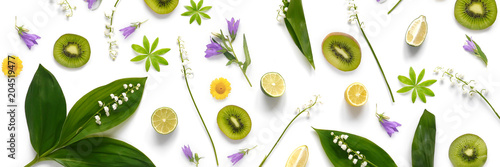 pattern from plants, wild flowers, lily of the valley, fruit kiwi, isolated on white background, flat lay, top view. The concept of summer, spring, Mother's Day, March 8.  - 204519477