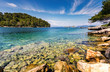 Beautiful view from the rocky coast to the azure sea.Landscape of rocky seashore with clear water of sea