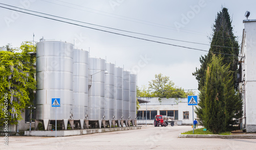 Shiny steel tanks stand in a row, Inkerman - Buy this stock