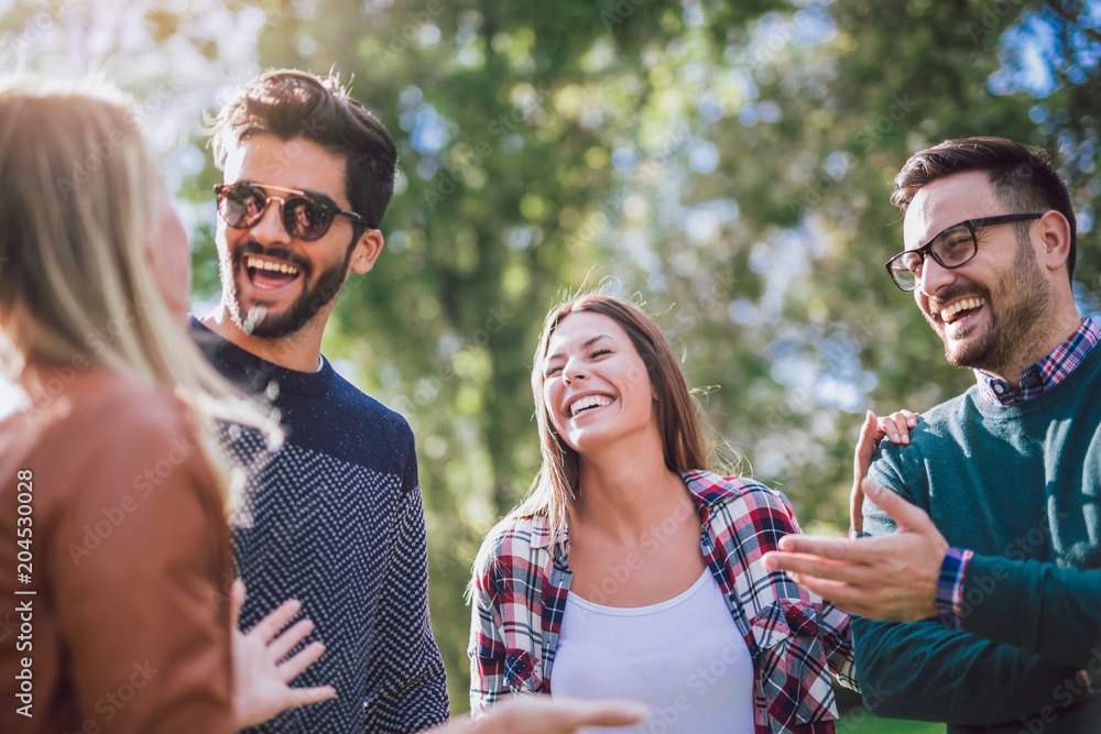 Fototapety, obrazy: Group of young people walking through park. Friends having fun outdoor