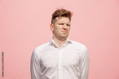 Fényképezés  Young man with disgusted expression repulsing something, isolated on the pink