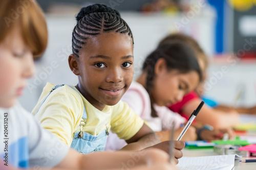 Obraz African girl at elementary school - fototapety do salonu
