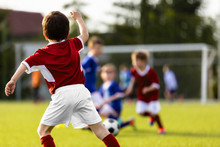 Children Playing Soccer Match....
