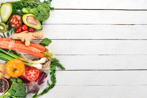 Poster Cuisine Healthy food. Vegetables and fruits. On a white wooden background. Top view. Copy space.