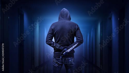 Criminal or bandit holding a knife. Wallpaper Mural