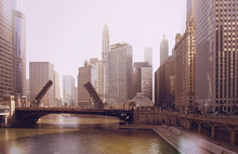 The Raising Of The Bridge On The Chicago River And Sailboats Move From Their Harbor On Lake Michigan. Vintage Photo Effect